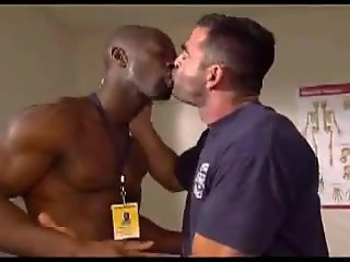 muscled black doctor checking gay patient