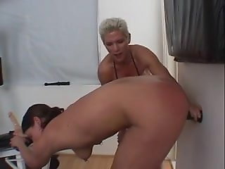 muscular dyke fucks submissive chick strap